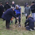 Max Parish and Paul Christie planting the first tree